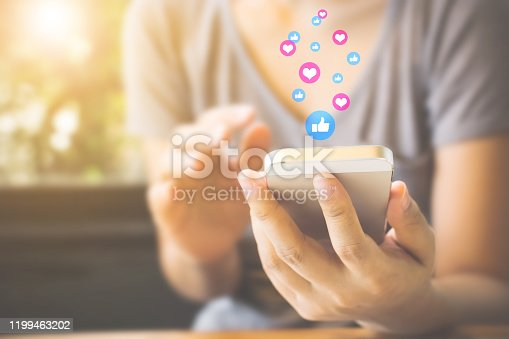 Woman hand using mobile smartphone with icon social media and social network. Online marketing concept
