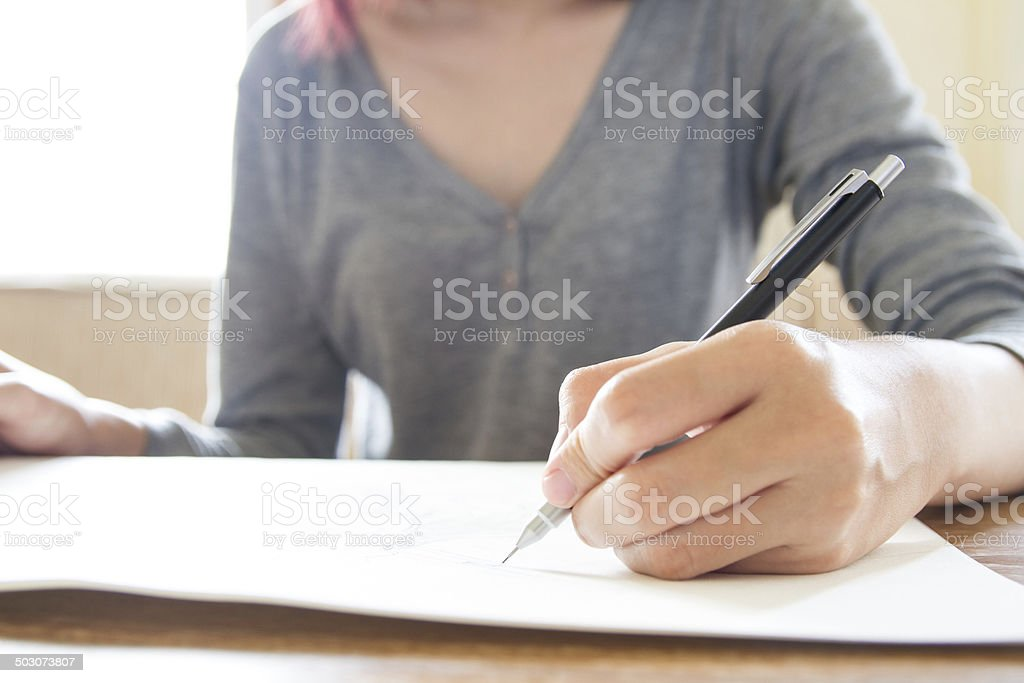 Woman hand using pencil drawing, sketching stock photo