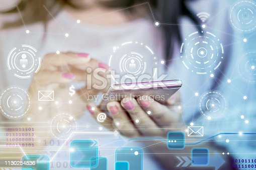 istock woman hand using smart phone with networking and modern technology background 1130254836
