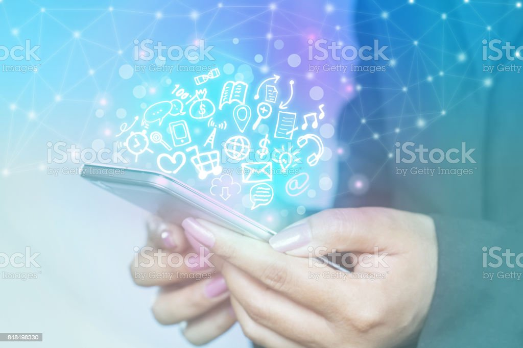 woman hand using smart phone with technology icon of social media and internet stock photo