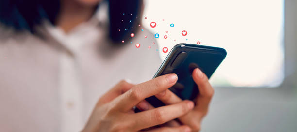 woman hand using smartphone and show heart icon social media. Concept social network. stock photo