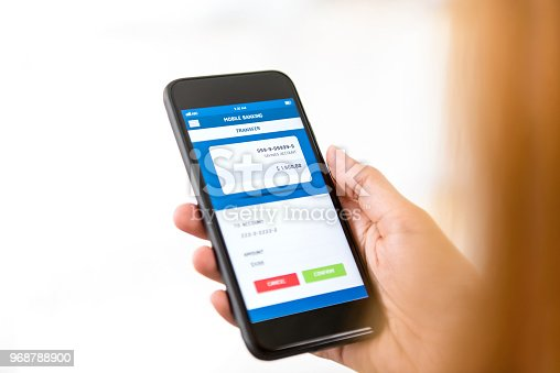 istock Woman hand using smartphone transferring money online 968788900