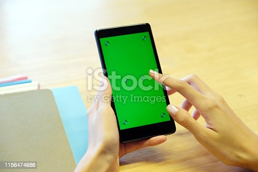istock Woman hand using smartphone with blank screen, business and technology, internet of things concept 1156474686