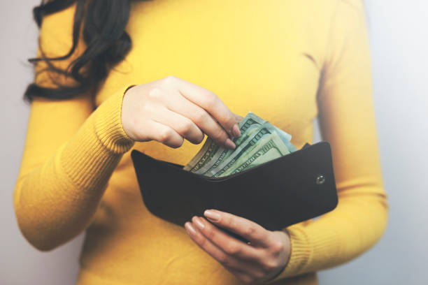 woman hand wallet and money stock photo