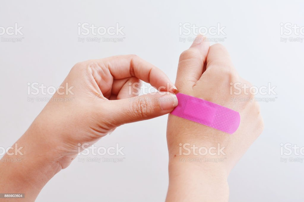 Woman hand with adhesive tape. stock photo