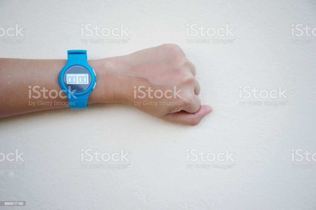 woman hand with blue stop watch at zero for start sport timing background stock photo