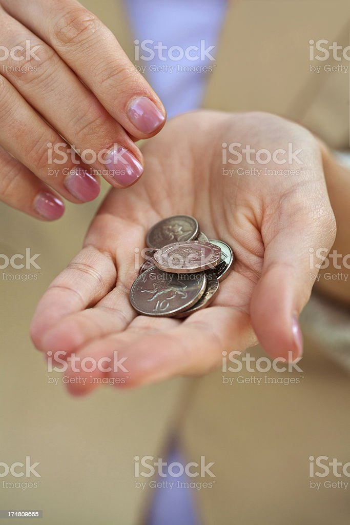 Woman hand with coins royalty-free stock photo