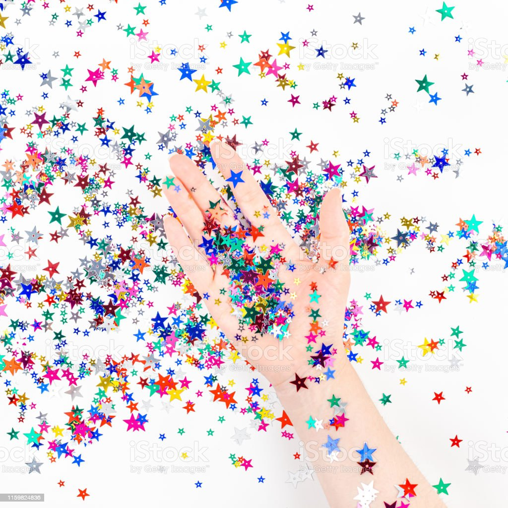 Woman Hand With Festive Color Star Confetti Stock Photo   Download Image Now