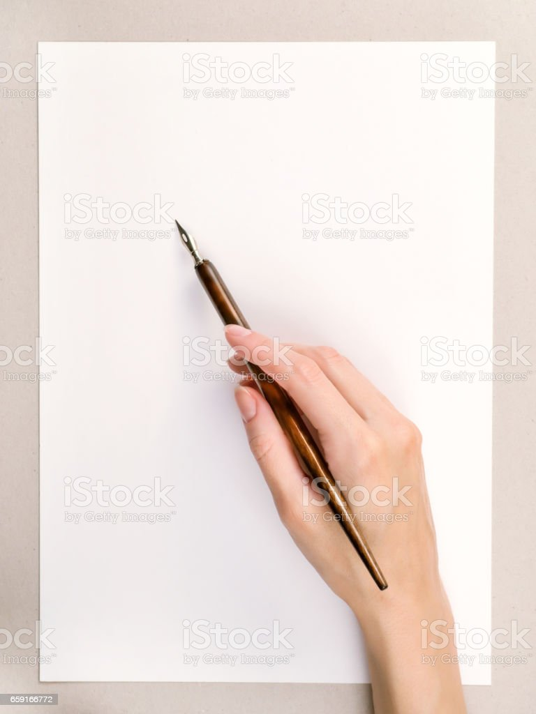 Woman hand with pen stock photo