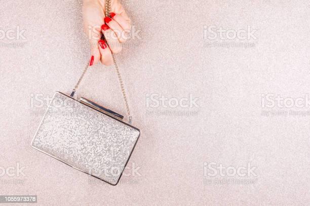 Woman hand with red manicure holding a small golden evening clutch picture id1055973378?b=1&k=6&m=1055973378&s=612x612&h=gktot1yzoxgyqahvrlgu6x3fvmb3 lb7vu4errukhcm=