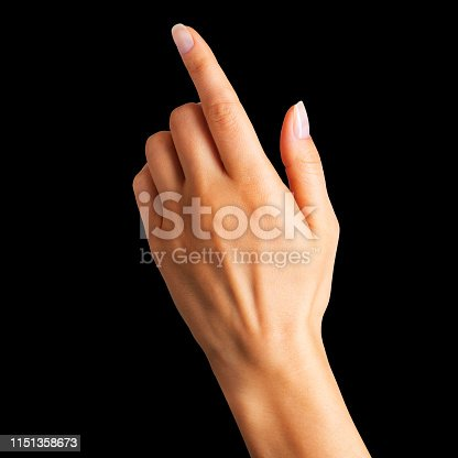 Woman hand with the index finger pointing up on black background Isolated with clipping path.