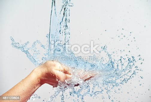 istock woman hand with water splashes and drops 481123804