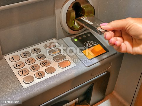 945598452 istock photo Woman hand withdrawing money at ATM 1178336821