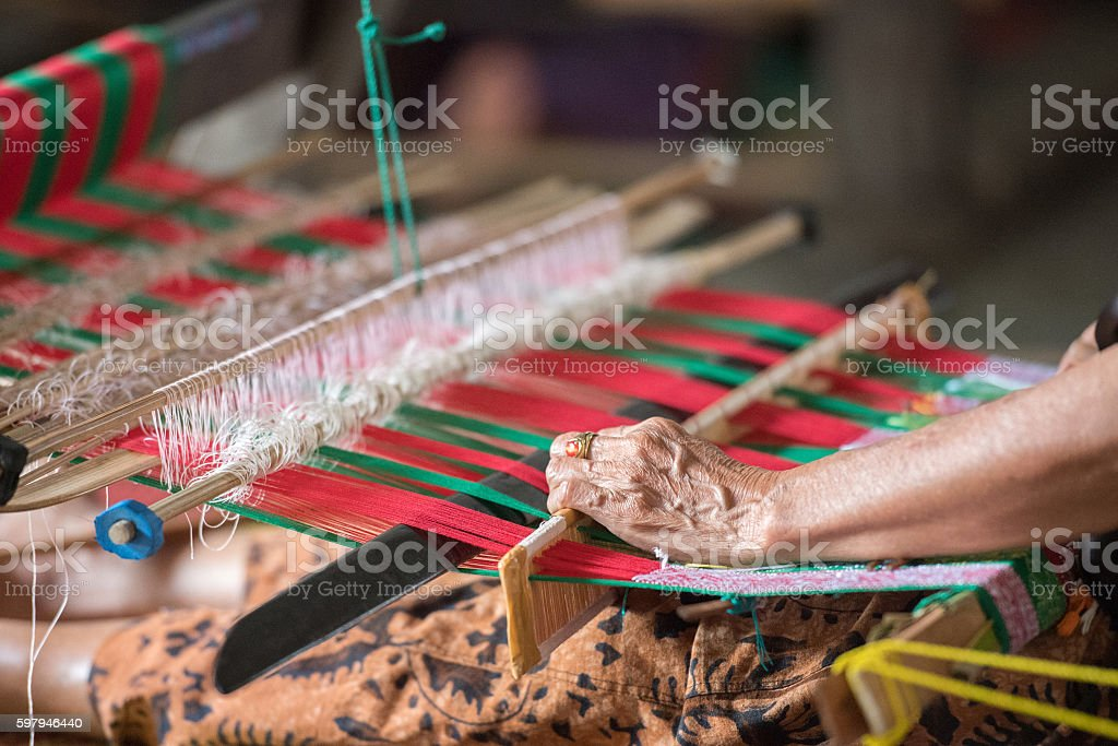 woman hand working at loom close up stock photo