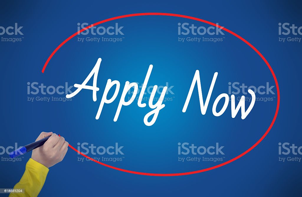 Woman hand writing apply now  with marker stock photo