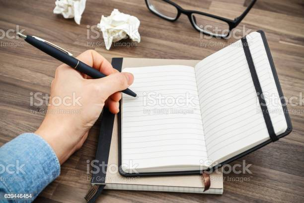 Woman Hand Writing On Notebook Stock Photo - Download Image Now