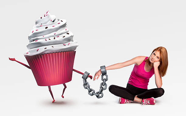 Woman handcuffed to a cupcake stock photo