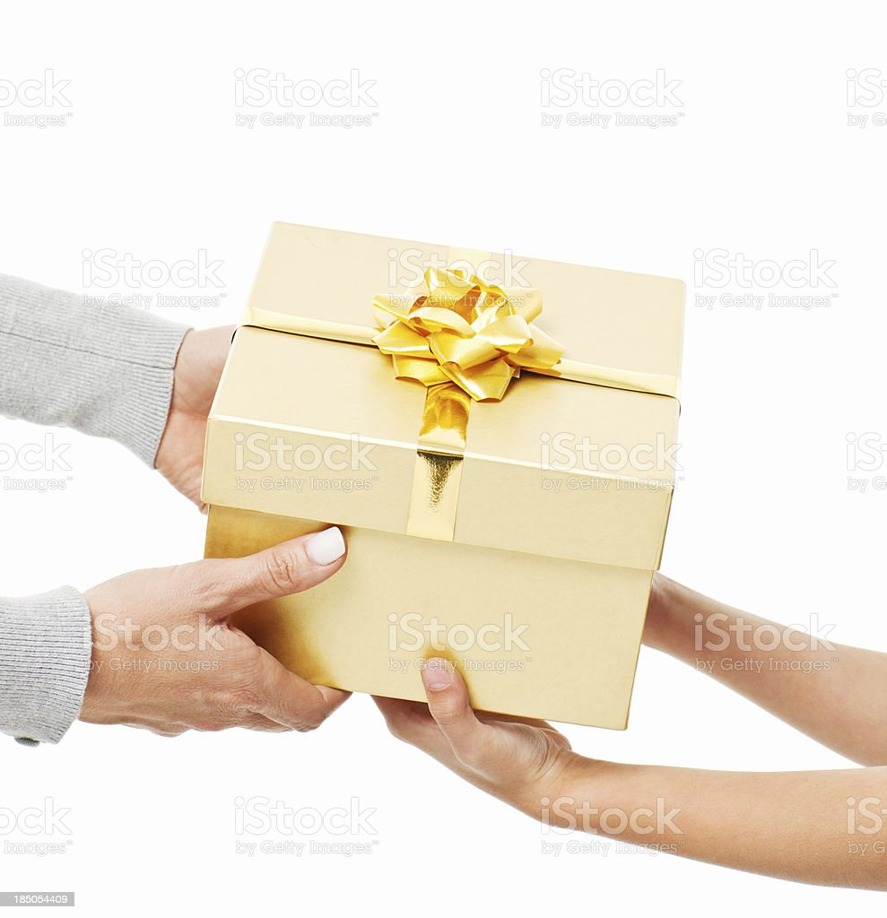 Woman Handing a Gift to Little Girl - Isolated royalty-free stock photo