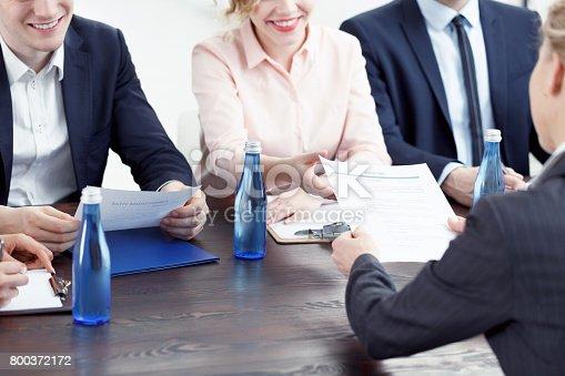 woman handing in her resume stock photo istock