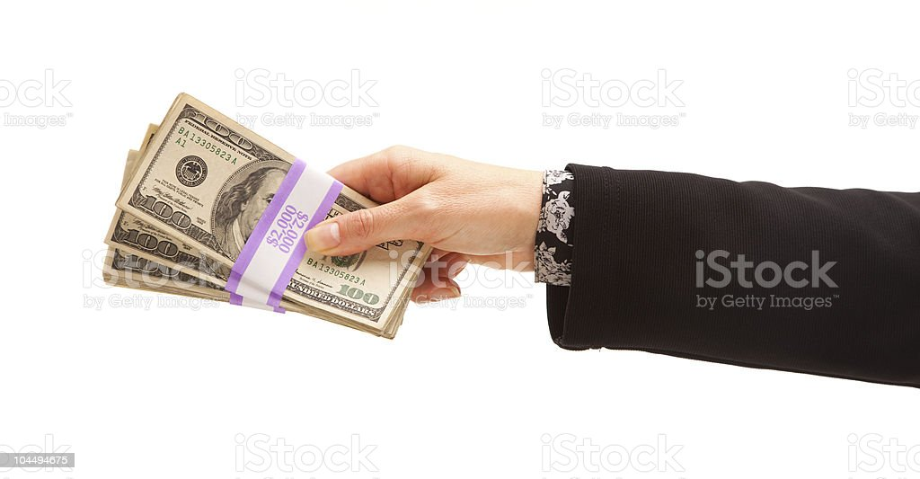 Woman Handing Over Hundreds of Dollars royalty-free stock photo