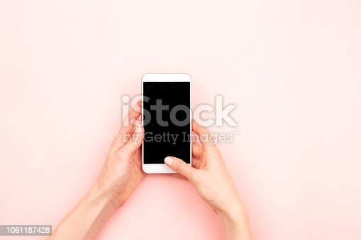 istock Woman hands and a smartphone 1061187428