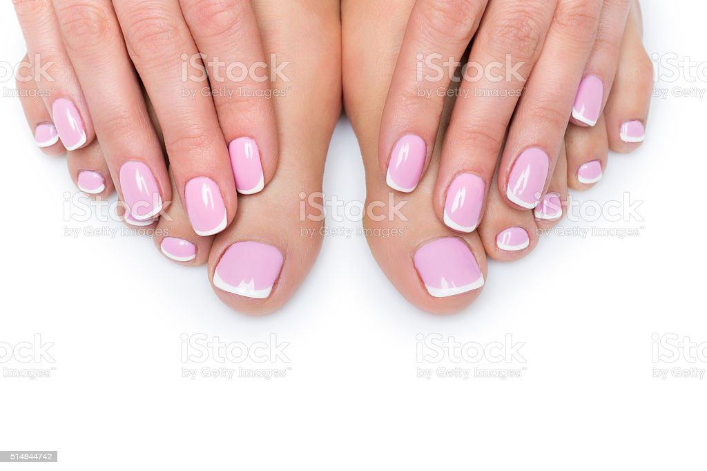 Woman hands and feet with french manicure stock photo