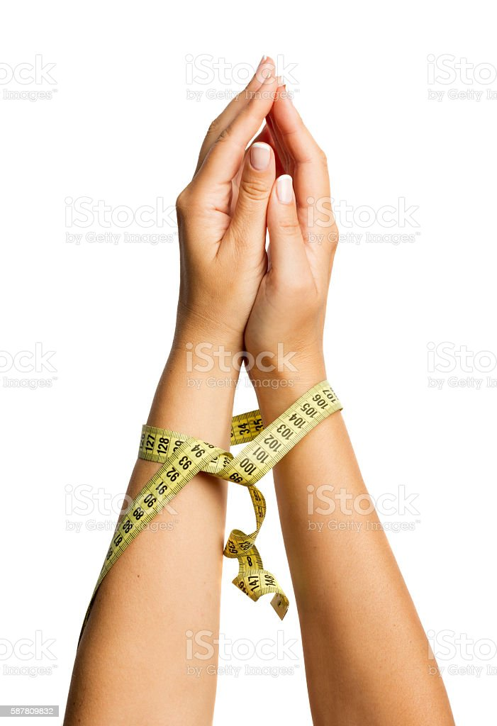 Woman hands bound a measure tape stock photo