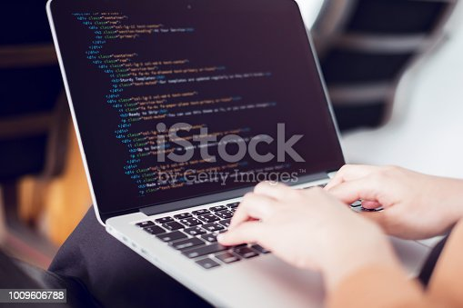 698430010 istock photo Woman hands coding html and programming on screen laptop, Web, developer. 1009606788