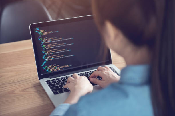 Woman hands coding html and programming on screen laptop, Web, developer. stock photo