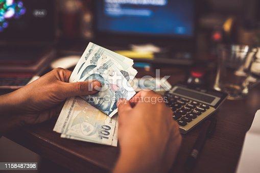 istock woman hands counting turkish lira 1158487398