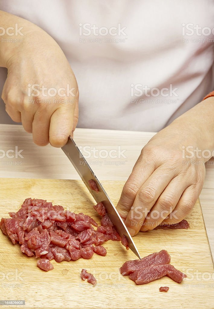Woman hands cutting beef royalty-free stock photo
