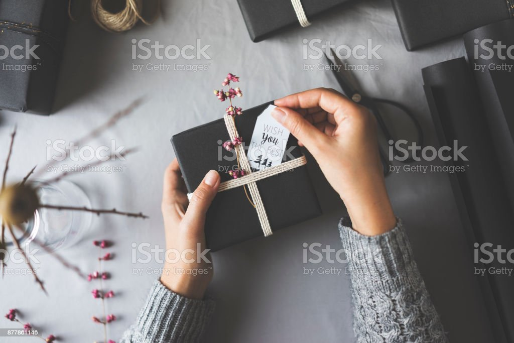 Woman hands gift wrapping Christmas presents, wish you the best stock photo