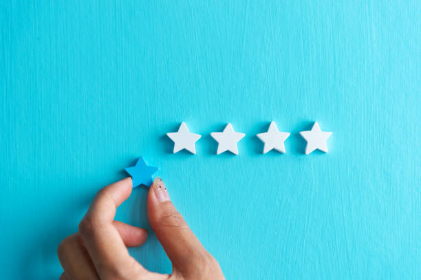 Woman hands give 4 star rating of customers satisfaction. stock photo