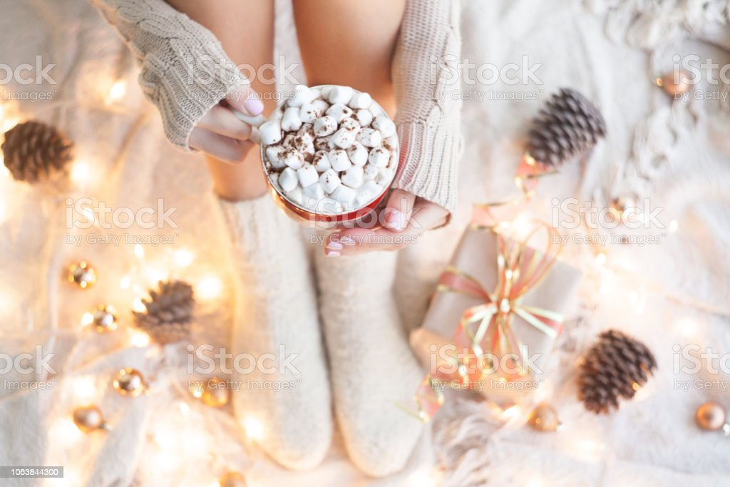 274b78d0c Woman hands holding a cup of coffee. Cozy winter concept. Winter hot drink.