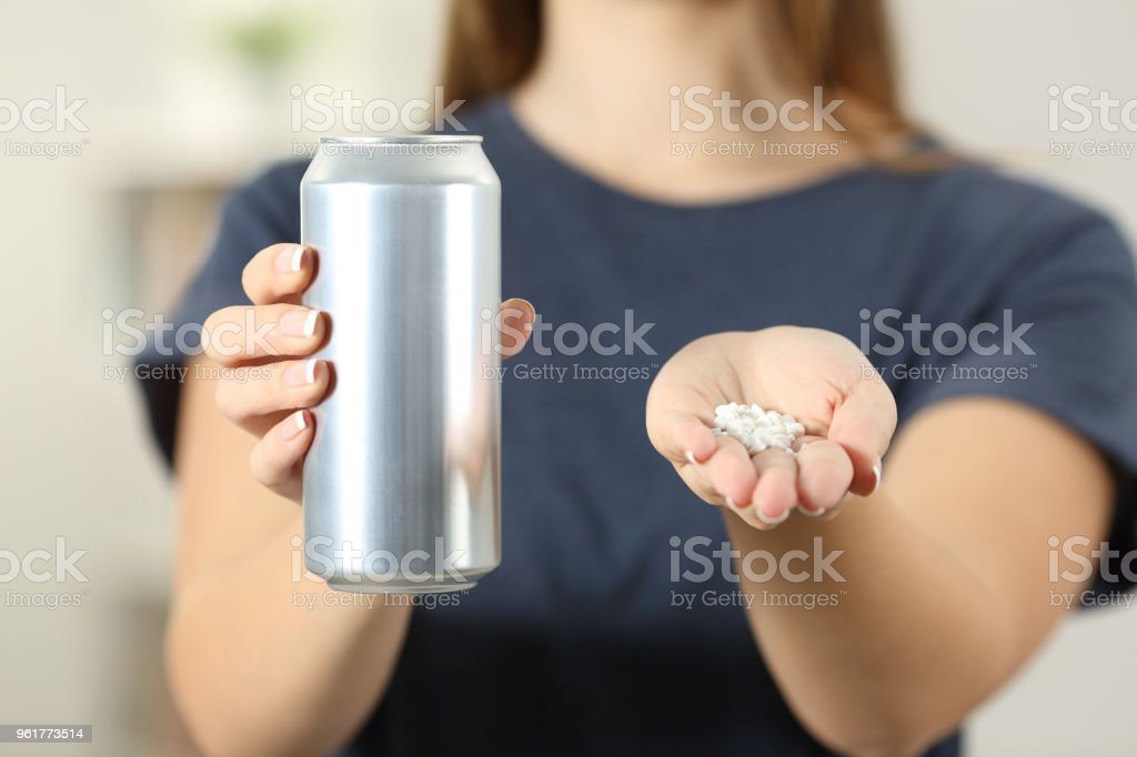 Woman hands holding a soda drink can and saccharin stock photo