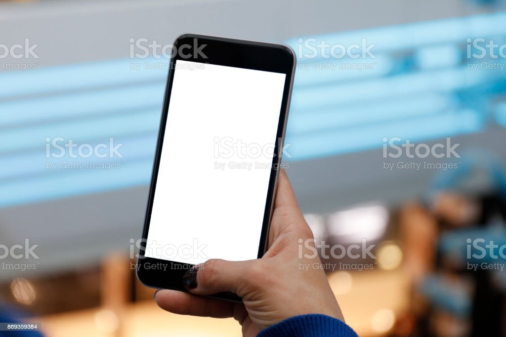 Woman hands holding and using smartphone with blank screen stock photo