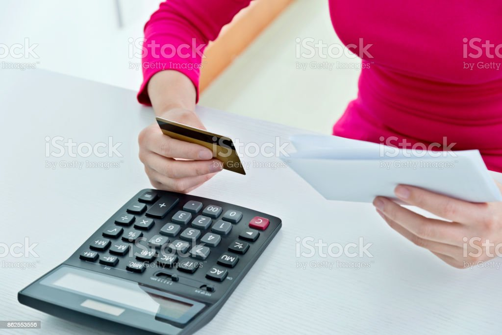 Woman hands holding bill and credit card stock photo