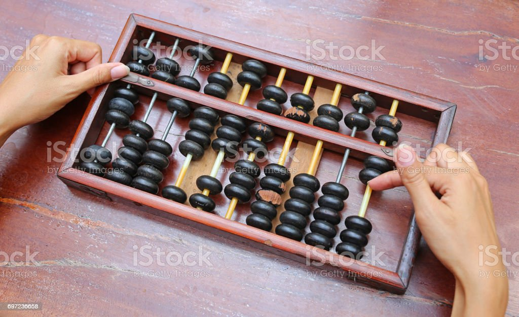 Woman hands holding Chinese ABACUS old antique calculator retro finance education ,tool work business accounting. stock photo