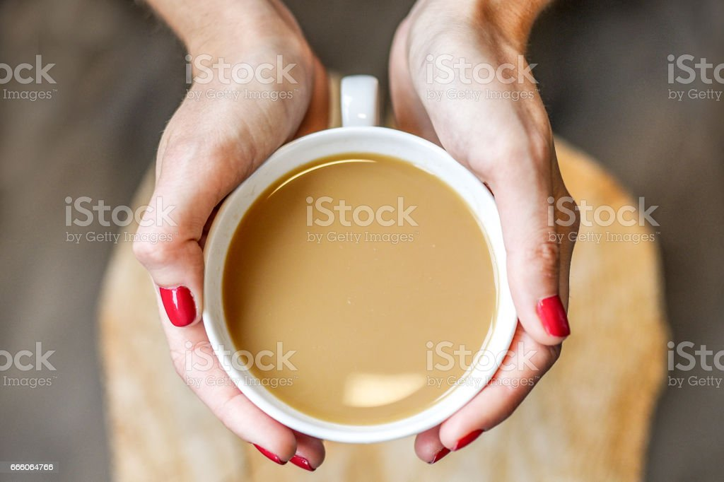 Woman hands holding cup of coffee stock photo