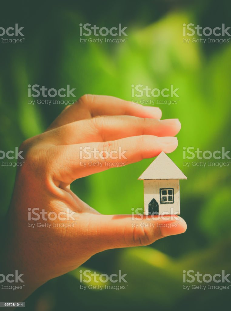 Woman hands holding house model stock photo