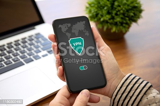 female hands holding phone with app vpn creation Internet protocols for protection private network in the office