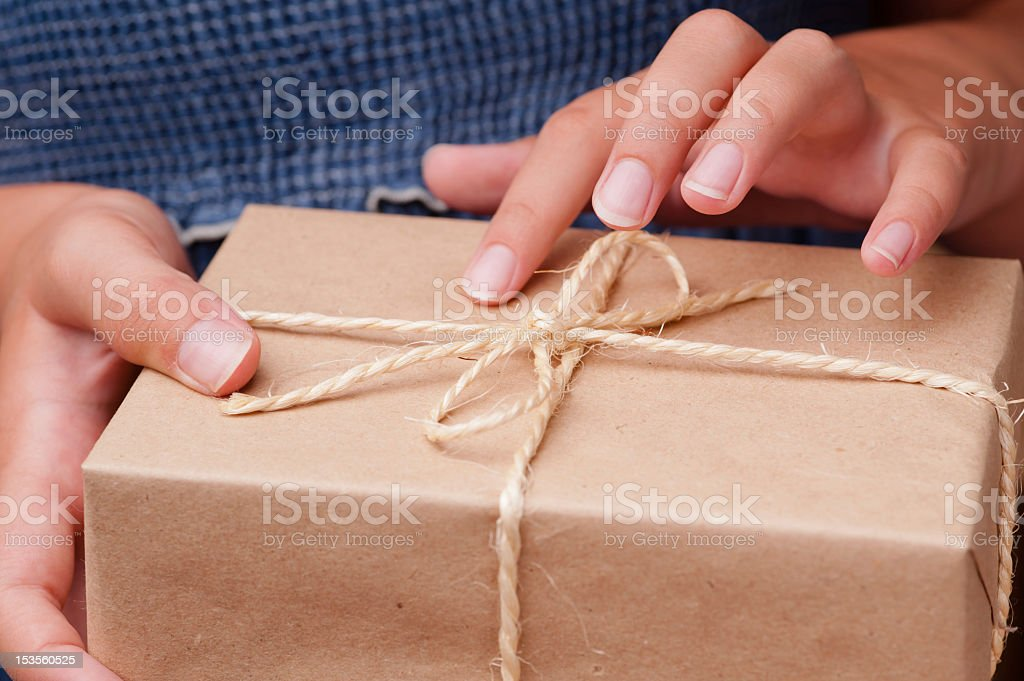 Woman hands holding small package royalty-free stock photo