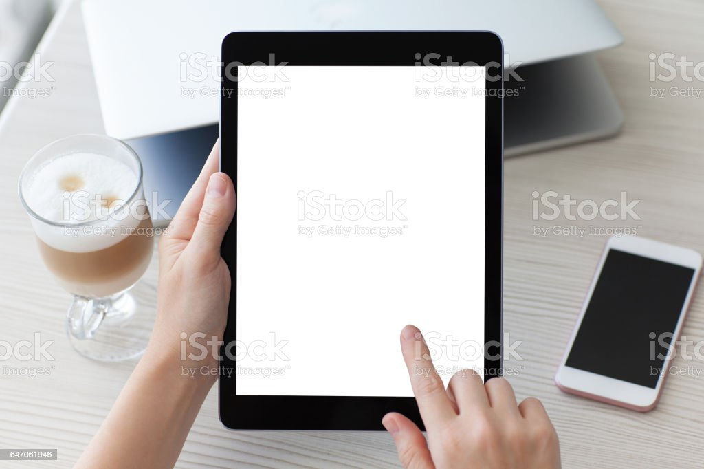 woman hands holding tablet computer isolated screen notebook and phone stock photo