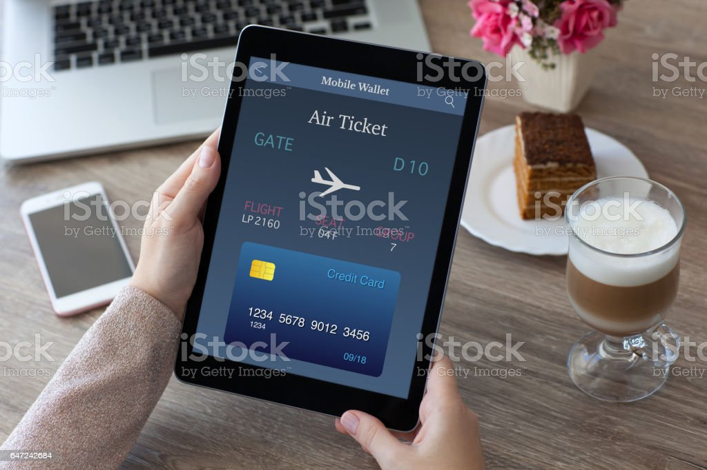 woman hands holding tablet computer PC with air ticket stock photo