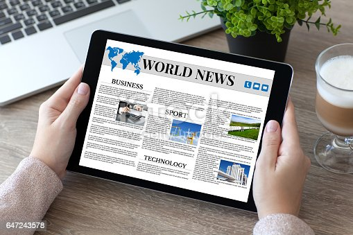 932821906 istock photo woman hands holding tablet PC computer with world news 647243578