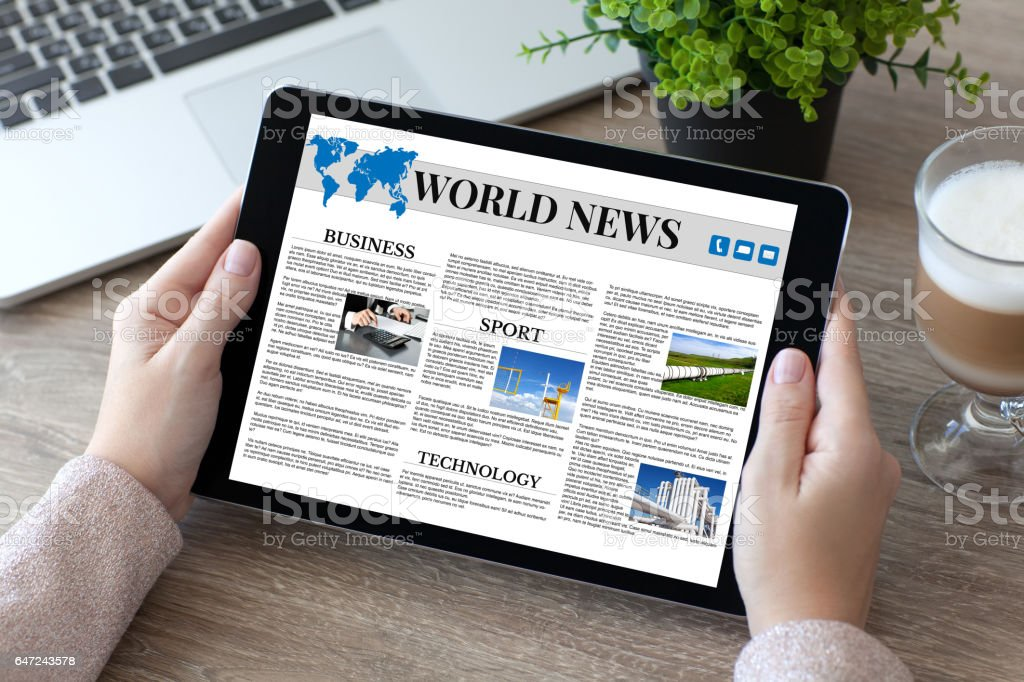 woman hands holding tablet PC computer with world news stock photo