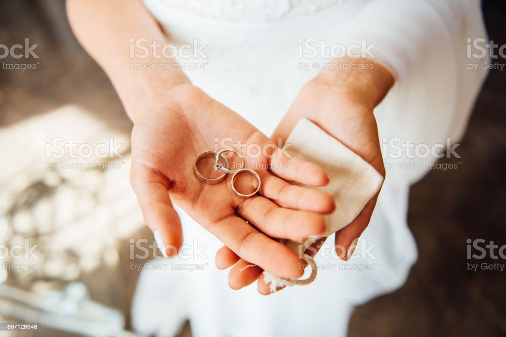 Woman Hands Holding Wedding Rings Stock Photo More Pictures of