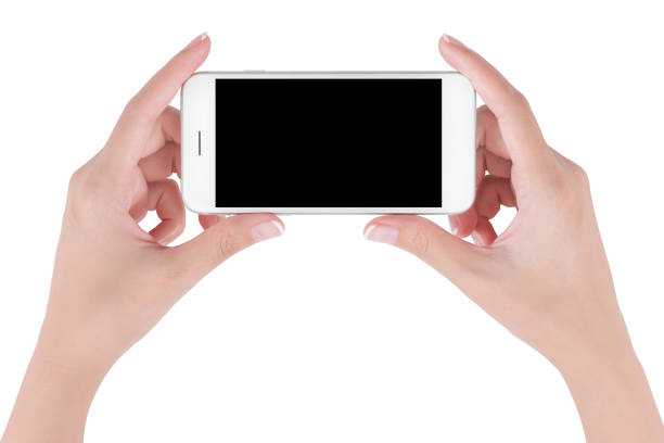 Woman hands holding white smart phone with blank space on screen display, digital and communication concept, Isolated on white background. stock photo