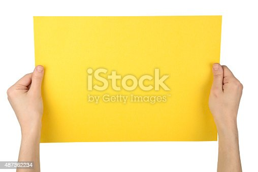 1159989540 istock photo Woman Hands Holding Yellow Paper 487362234