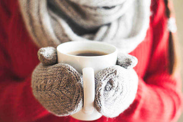 woman hands in gloves holding a mug - tea hot drink stock photos and pictures